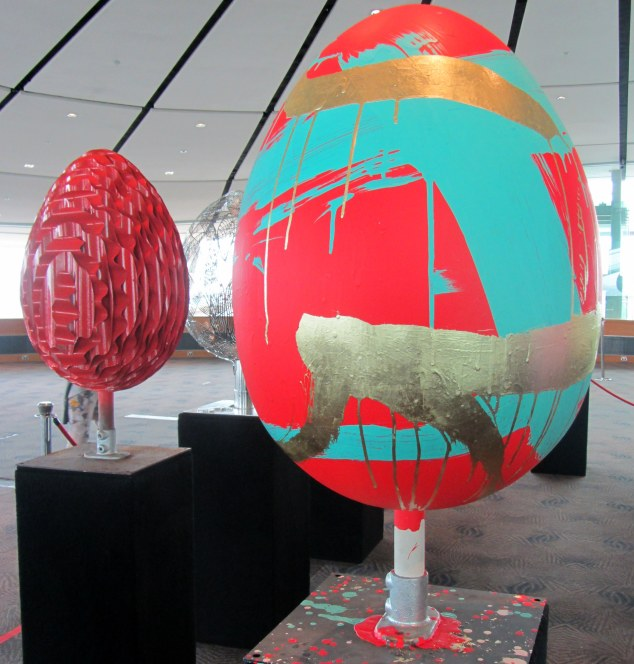 Foreground: #Egg57 World Egg by Max Gimblett. Background: #Egg37 Red by Jeff Thompson