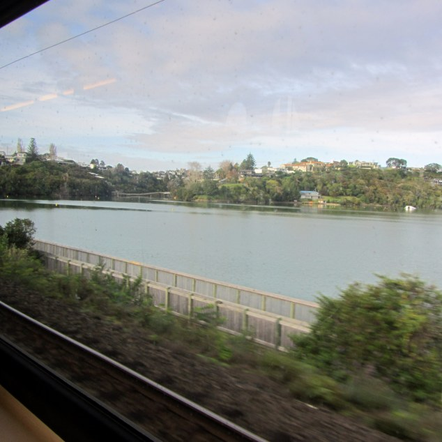 View of Orakei Basin boardway from train