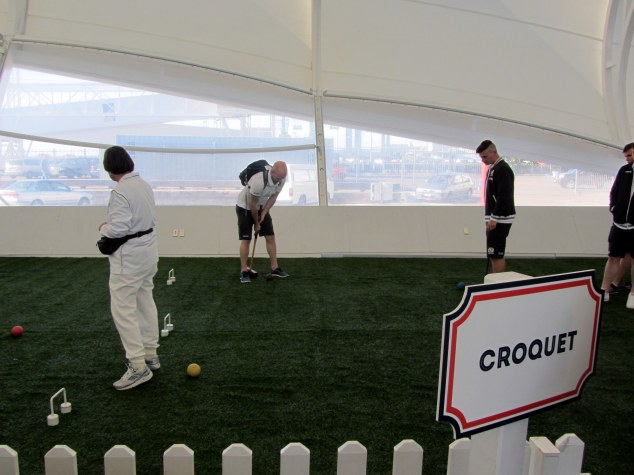 Under 20 Scotland team play croquet