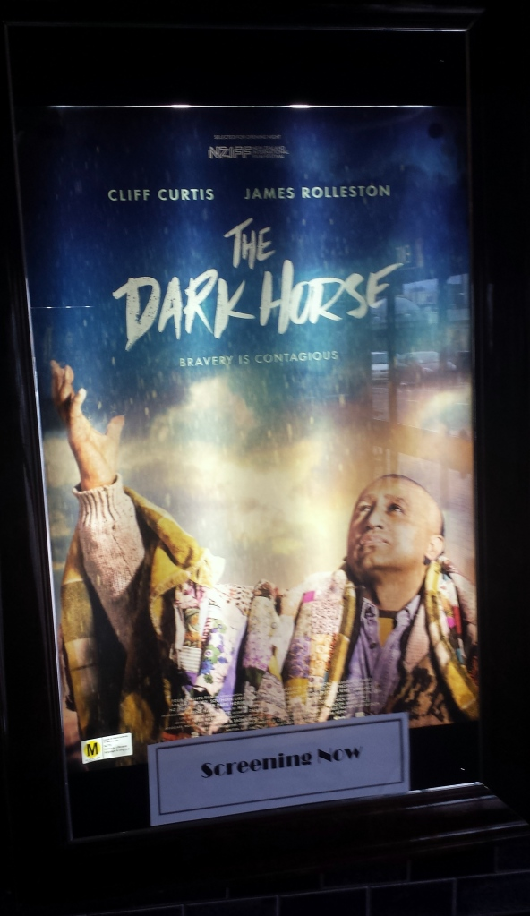 Wall poster advertising 'The Dark Horse'